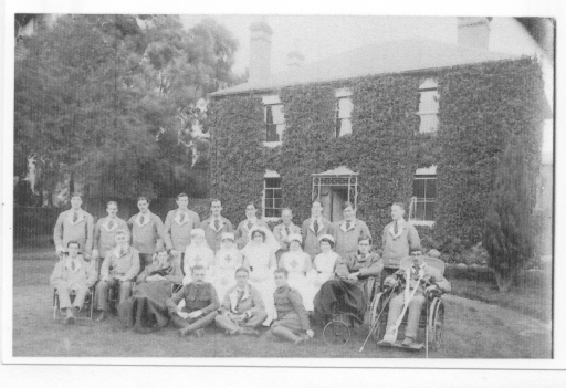 Patients and staff outside Trellis Cottage