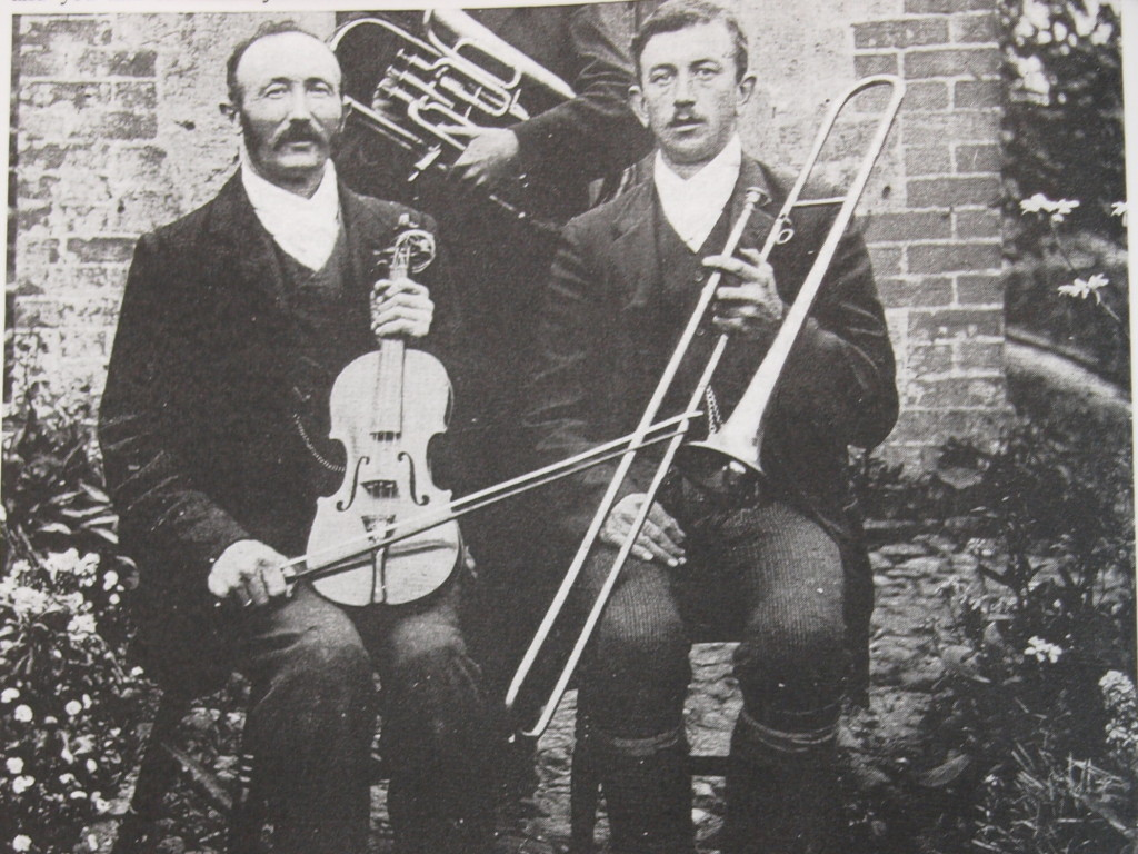 Henry William Blagdon is the younger man with the Trombone; his father is on the left with the violin